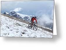 A Mountain Biker Rides Through The Snow Greeting Card