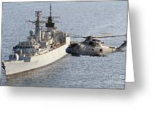 A Royal Navy Merlin Helicopter Passes Over Hms Cumberland Greeting Card