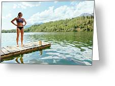 A Woman Is Standing On A Jetty Greeting Card