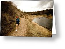 A Woman Jogging On A Dirt Trail Greeting Card