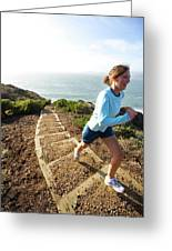 A Woman Running Stairs Near The Ocean Greeting Card
