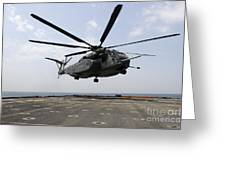 An Mh-53e Sea Dragon Prepares To Land Greeting Card