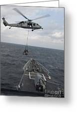 An Mh-60s Sea Hawk Helicopter Delivers Greeting Card