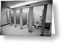 cubicle toilet stalls in womens bathroom in a High school canada north america Greeting Card
