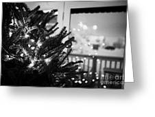 decorated christmas tree looking out of window to snow covered scene in small rural village of Forge Greeting Card