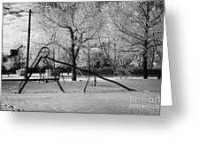 empty childrens playground with hoar frost covered trees on street in small rural village of Forget  Greeting Card