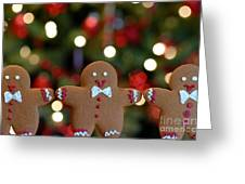 Gingerbread Men In A Line Greeting Card by Amy Cicconi