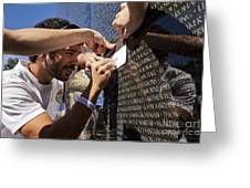 Man Getting A Rubbing Of Fallen Soldier's Name At The Vietnam War Memorial Greeting Card