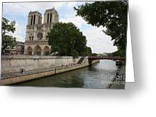 Notre Dame Along The Seine Greeting Card