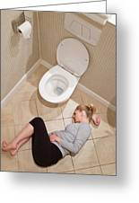 Pregnant Woman Lying On Bathroom Floor Greeting Card