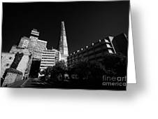 the shard building towering over local buildings including guys hospital in southwark London England Greeting Card