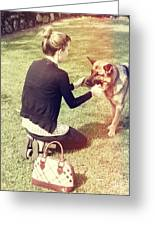 Young Woman In 20s Playing Fetch With Her Dog Greeting Card
