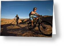 Couple Mountain Biking, Moab, Utah Greeting Card