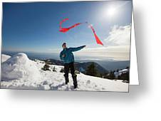 Flying A Kite On A Snowy Mountain Greeting Card