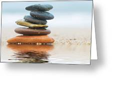 Stack Of Beach Stones On Sand Greeting Card