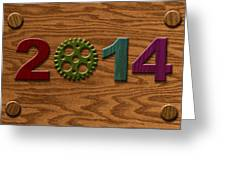 2014 Wooden Gear On Wood Grain Texture Background Greeting Card
