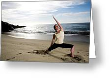 A Women At The Beach Performing Yoga Greeting Card