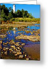 The Cana Island Lighthouse In Baileys Harbor Reflective Waters. Greeting Card