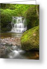 Stunning Waterfall Flowing Over Rocks Through Lush Green Forest  Greeting Card
