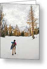 A Backpacker Hikes Through Snow Greeting Card