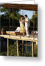 A Couple Having Drinks On A Deck Greeting Card
