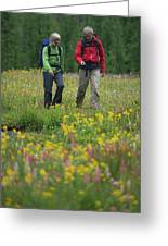 A Couple Hikes Through A Field Greeting Card