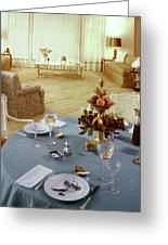 A Dining Room With A Blue Tablecloth And Ornate Greeting Card