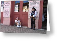 A Dog And A Re-enactor Rest In The Front Of The Bird Cage Theater Tombstone Arizona Greeting Card