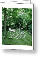 A Garden With Checkered Pavement Greeting Card