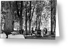 A Group Of People Eating Lunch Under Trees Greeting Card