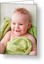 A Happy Baby Lying On Bed In Green Towel Greeting Card