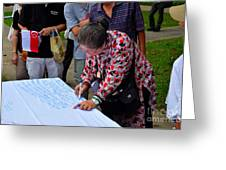 A Lady Signs Petition At May Day Rally Singapore Greeting Card