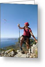 A Male Climber Looking At Paragliding Greeting Card