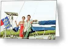 A Man And A Woman Embrace In Sailboat Greeting Card