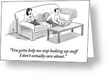 A Man And A Woman Sit On A Couch.  The Man Greeting Card