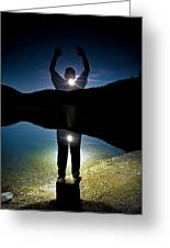 A Man Balances On A Log At Night Greeting Card