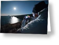 A Man Captures The Full Moon Greeting Card