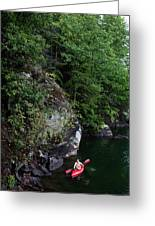 A Man Floats Along In A Kayak Greeting Card