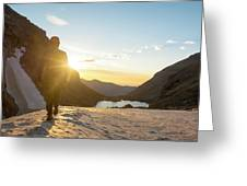 A Man Hiking On Snowfield At Sunrise Greeting Card