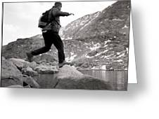 A Man Jumps From One Rock To Another Greeting Card