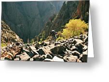 A Man Navigates A Rock Scree Field Greeting Card