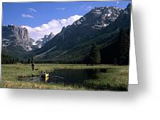 A Man Pulls His Canoe Up A River Valley Greeting Card