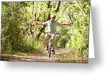 A Man Rides A Bicycle Greeting Card