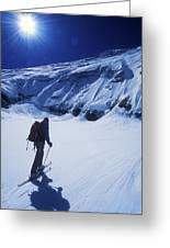 A Man Ski Touring Under Blue Skies Greeting Card