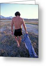 A Man Takes Off His Clothes And Walks Greeting Card