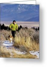 A Man Trail Runs On A Winter Day Greeting Card