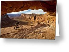 A Mountain Biker Rides By On Slickrock Greeting Card