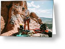 A Rock Climber Setting Up To Climb Greeting Card