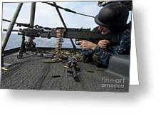A Sailor Fires An M-240b Machine Gun Greeting Card by Stocktrek Images