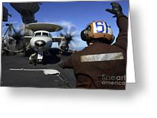 A Sailor Signals To Pilots Of An E-2c Greeting Card
